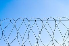 Barbed wire against the sky Royalty Free Stock Images