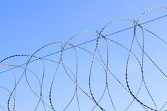 Barbed wire against the sky Royalty Free Stock Photography