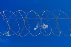 Barbed wire against the sky Stock Image