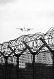 Barbed wire airport fence Stock Images