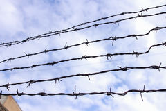 Barbed wire. Also known as barb wire, less often bob wire or, in the southeastern United States, bobbed wire, is a type of steel fencing wire constructed with Stock Photo