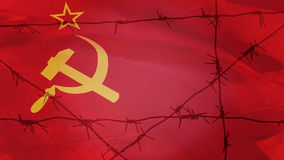 Barbed wire on the background of the flag of the USSR.  Royalty Free Stock Photos