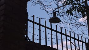 Barbed wire. And outdoor light on blue sky stock video footage
