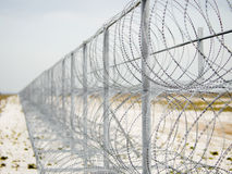 Barbed Wire Barrier Stock Photo