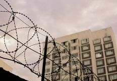 View from prison. Barbed wire black silhouette on the sky stock photo