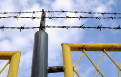 Barbed wire and blue skies Royalty Free Stock Photos
