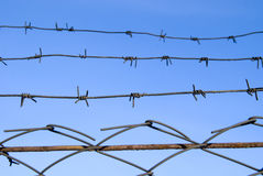Barbed wire on blue sky. Background Stock Photo