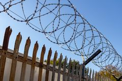 Barbed wire on blue sky background - Lost freedom and hope concept stock photos