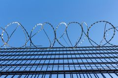 Barbed wire on blue sky background - Lost freedom and hope concept stock image