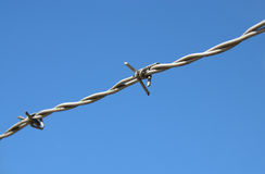 Barbed wire blue sky background Royalty Free Stock Images