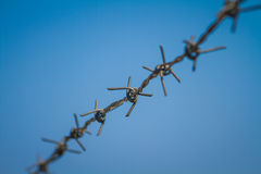 Barbed wire with blue sky Stock Photos