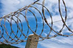 Barbed wire boundary. Protected site with barbed wire boundary royalty free stock images