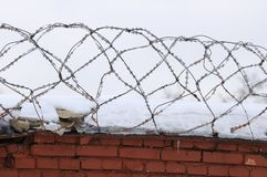 Barbed Wire on Brick Fence Stock Images