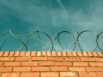 Barbed Wire On A Brick Wall Royalty Free Stock Photos