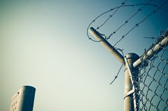 Barbed wire and building Stock Photo