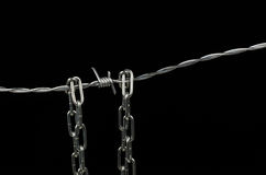 Barbed wire and chain Stock Image