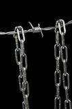 Barbed wire and chain Royalty Free Stock Image