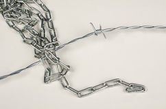 Barbed wire and chain Stock Photo