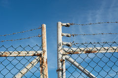 Barbed-wire and chain-link fence Royalty Free Stock Images