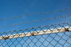 Barbed-wire and chain-link fence Stock Photo