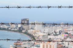 Barbed wire and city view. Background Royalty Free Stock Image