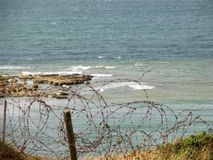 Barbed Wire on the Cliff of Pointe Du Hoc. Normandy , France Royalty Free Stock Images