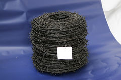 Barbed wire coil Stock Photo
