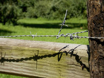 Barbed Wire on a Corner Fence Post Stock Images