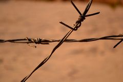 Barbed wire cross Stock Photos