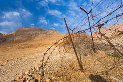 Barbed wire in desert. Royalty Free Stock Photo