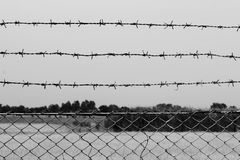 Barbed wire detention center at countryside and background gray color style. Wire Barbed detention center at countryside and background gray color style stock image