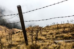 Barbed wire on the edge of a cliff. Concept of limiting individual freedom.  stock images