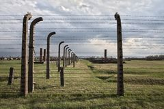 Barbed wire and fance around a concentration camp. Stock Images