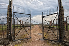 Barbed wire and fance around a concentration camp. Side entrance of the concentration camp. Stock Photo