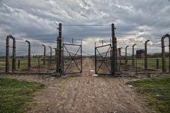 Barbed wire and fance around a concentration camp. Side entrance of the concentration camp. Museum Auschwitz - Birkenau. Holocaust Memorial Museum.  Barbed wire Stock Photos