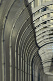 Barbed wire fence. Grey tall fence with barbed wire on it Royalty Free Stock Photo
