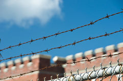 Barbed wire and fence. On castle and sky background Stock Image
