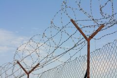 Barbed wire fence. Against sky Stock Photos
