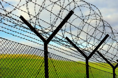 Barbed-wire fence Royalty Free Stock Image