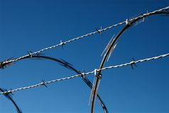 Barbed Wire fence. A close up shot of a sharp barbed wire fence stock photos