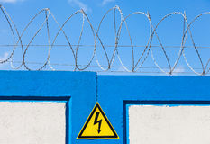 Barbed wire on the fence against Stock Images