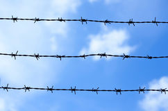 Barbed wire fence against sky and cloud Royalty Free Stock Image