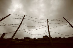 Barbed Wire Fence And Wall Stock Images