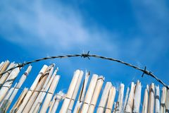 Barbed wire on a fence stock photos