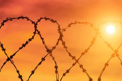 Barbed wire on the fence. Area with restricted access Royalty Free Stock Photos