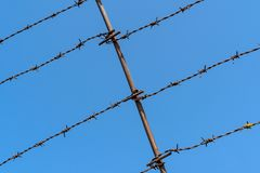 Barbed wire Fence. On clear sky background royalty free stock image