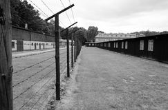 Barbed wire fence and barracks in concentration camp Stutthof Stock Image