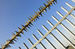 Barbed wire fence at the blue sky Royalty Free Stock Photo