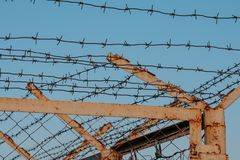 The barbed wire fence on blue sky background Stock Photos