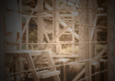 Barbed Wire Fence border the dangerous area Royalty Free Stock Images